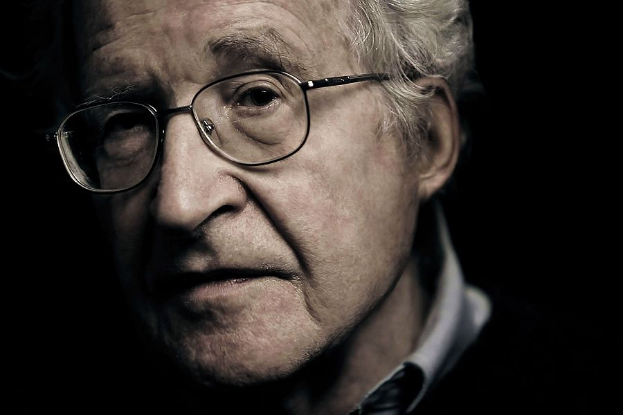 Explore how Noam Chomsky dissects principles and policies that led to the unequal distribution of wealth and power in the American society.